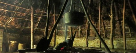 A pot over the fire inside a thatched hut in Henllys Iron Age Fort of Wales