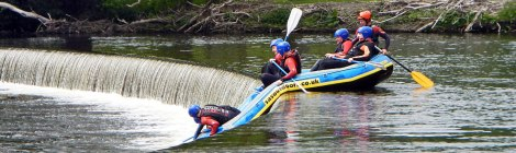 Rafters attempting to negotiate the 'falls' part of Horseshoe Falls inLlangollen, Wales
