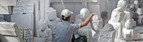 1000 white marble Buddhas can be found on the 'Street of Stone Carvers' in Mandalay, Myanmar