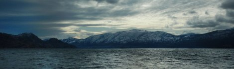 Dark sky over Okanogan Lake whilst walking on a cold, cold day in Peachland, Canada