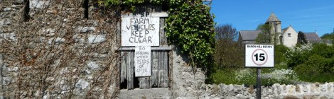 Abandoned building with home-made signs near Penmon on Anglesey Island, Wales