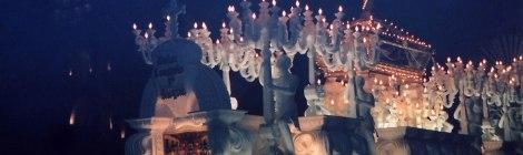 Semana Santa processions lit up at night in Antigua, Guatemala